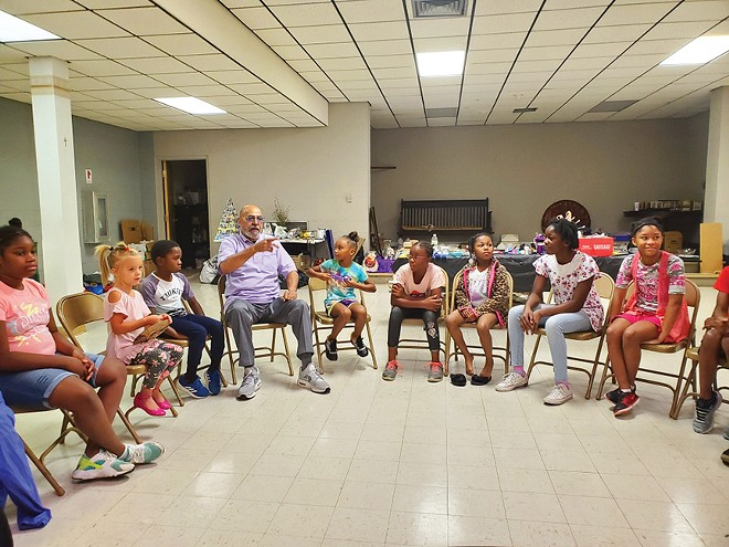 "Scott engages children in ""circle time."" - PHOTO COURTESY OF GARVEY-TUBMAN CENTER"