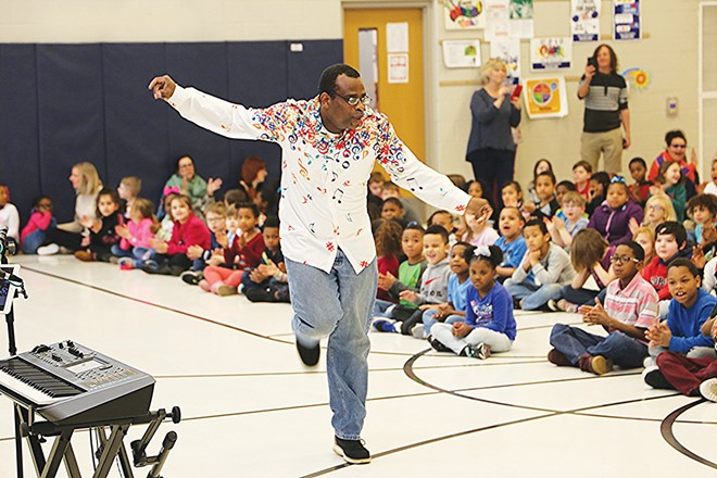 Robert Sampson performs for the students at Enos Elementary in Springfield. - PHOTO COURTESY MICHAEL GOZA / ILLINOIS CENTRAL BLUES CLUB