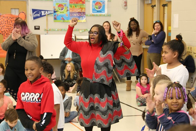 Students and faculty dancing while Robert Sampson performs at Enos Elementary in Springfield. - PHOTO COURTESY MICHAEL GOZA / ILLINOIS CENTRAL BLUES CLUB