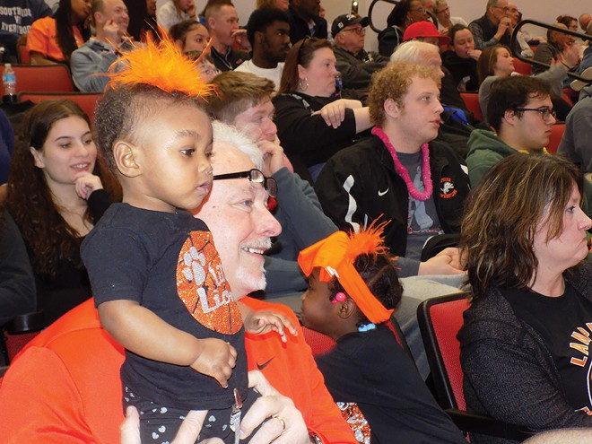 Girls matter, too: Lanphier High School fans take in the girls team's first appearance in a state finals basketball tournament last week.