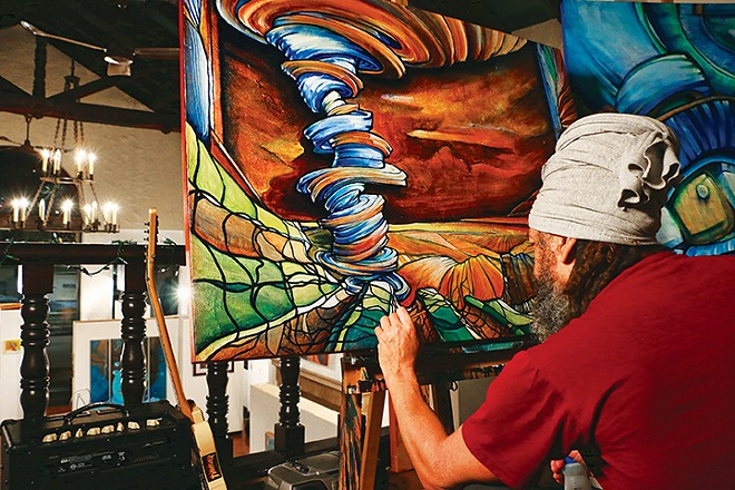 Local artist Jeff Williams at work in - The Pharmacy Gallery and Art Space. - PHOTO PATRICK YEAGLE