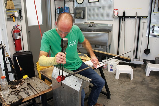 Dathan Powell recently took his first class in glass-blowing and plans to continue with more advanced courses. - PHOTO BY JANET SEITZ