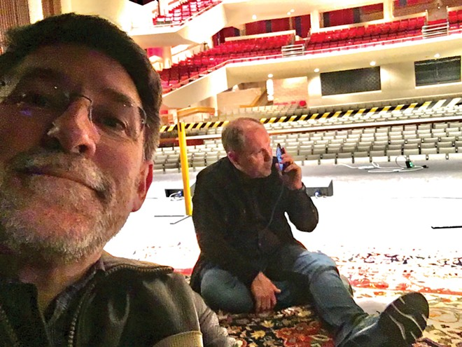 UIS Performing Arts Center Director Bryan Rives and event promoter Don Kronberg sit in an empty Sangamon Auditorium the night Ron White was scheduled to perform.