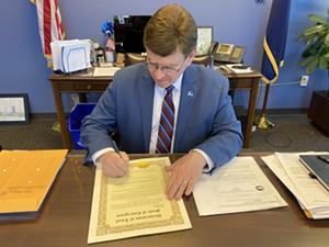 Mayor Jim Langfelder signs an emergency declaration. - PHOTO COURTESY OF CITY OF SPRINGFIELD