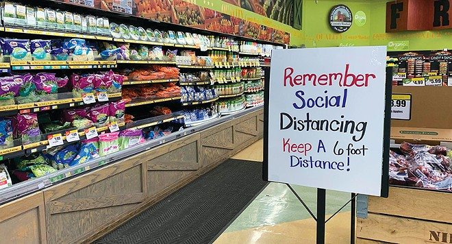Grocery stores in Illinois should post signs reminding customers to follow social distancing rules, Gov. JB Pritzker said recently. - PHOTO BY MARY HANSEN / NPR ILLINOIS.
