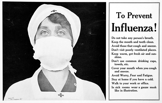 A Red Cross nurse with a gauze mask. - PHOTO BY PAUL THOMPSON / PHOTO COURTESY SANGAMON VALLEY COLLECTION