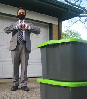"""Ryan Fernandez of MenuGem uses bins for """"contactless"""" transfer of groceries to customers. - COURTESY OF RYAN FERNANDEZ"""