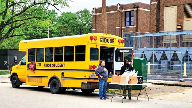 Families picked up free meals from various schools and satellite bus locations, this one outside of Feitshans Elementary School on South 15th Street. - PHOTO BY  RACHEL OTWELL