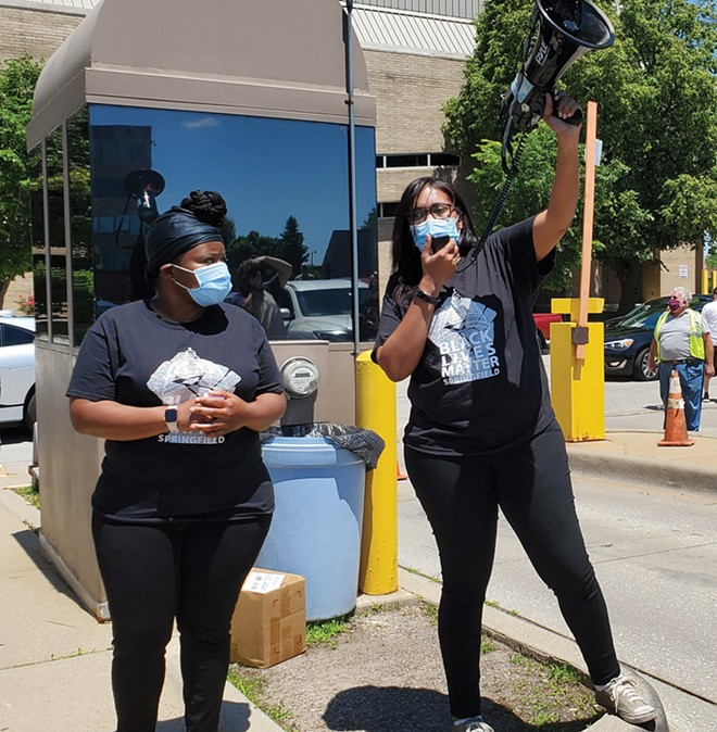 Khoran Readus and Sunshine Clemons lead Black Lives Matter Springfield. They were surprised by the number of people who showed up for the car procession they planned. - PHOTO BY RACHEL OTWELL.