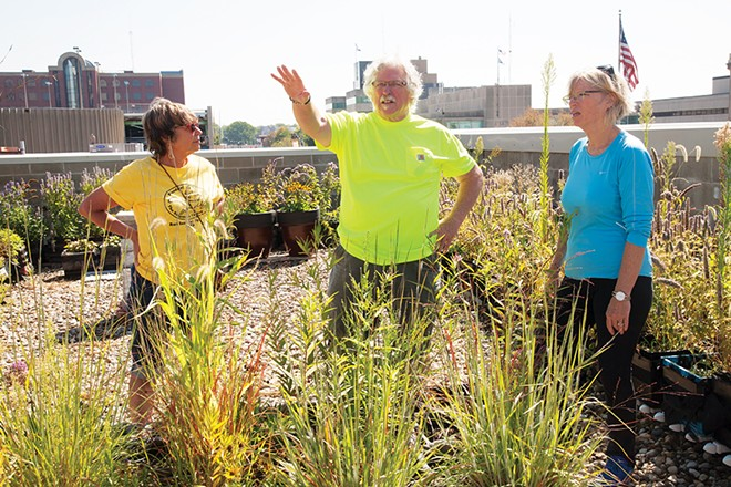 Michael Higgins, center, Grace Norris, left, and Susan Helm, right, on the rooftop garden above Maldaner's.