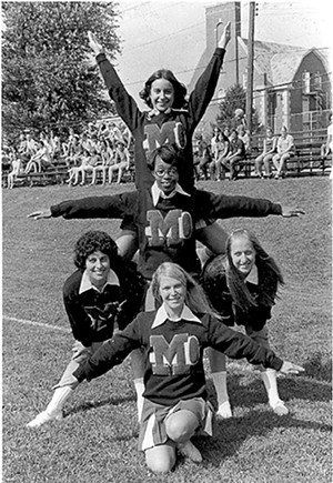 The 1971 varsity cheerleading squad on - the soccer field. - PHOTOS COURTESY MACMURRAY COLLEGE.