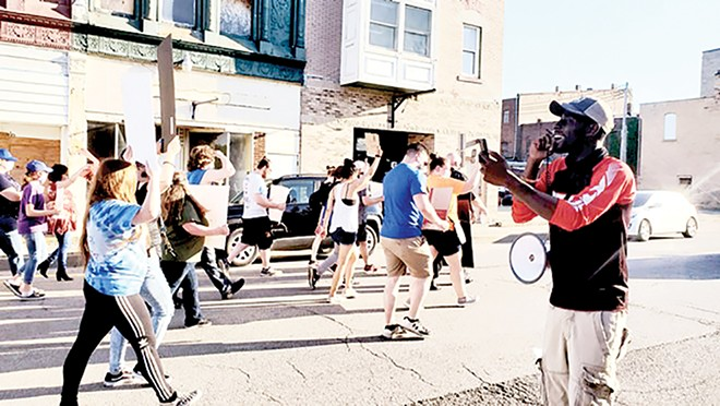 Chadwick Workman of Langleyville leads a march in Taylorville on Thursday, June 4.