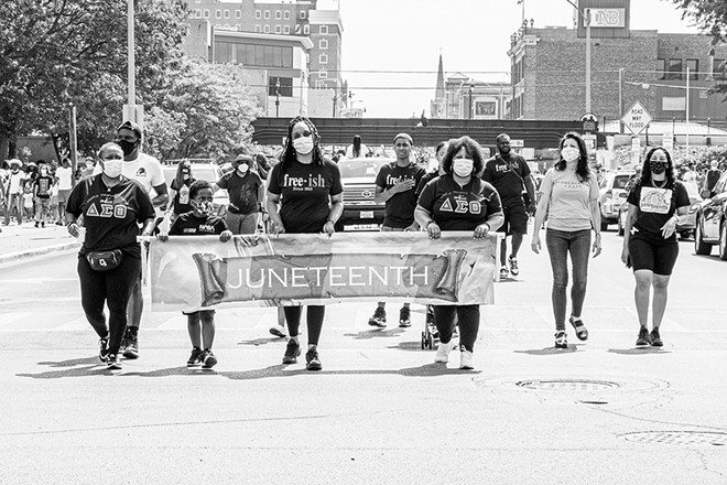 This year instead of Juneteenth celebrations at Comer Cox Park, participants marched to the Capitol. - PHOTO BY ZACH ADAMS, 1221 PHOTOGRAPHY.