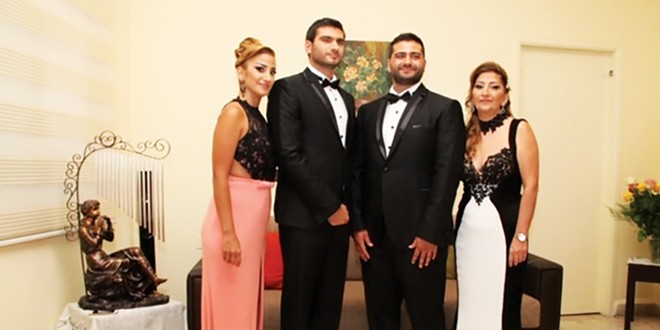 From left, siblings Nadine, Elie and Nabih Elhajj, with their mother, Zeina, in her living room in Beirut in 2015.