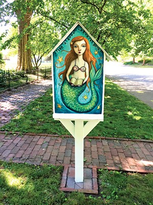 A Little Free Library in the 1500 block of North Third Street is decorated with fairy tale characters. - PHOTO BY DEBBI GEORGE
