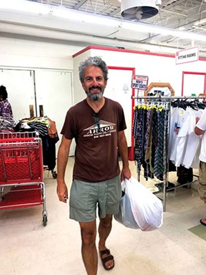 The writer's husband, Josh, is wearing a vintage T-shirt from a previous year's visit to 11th & Jeff, while holding his latest treasures from there. - PHOTO BY LISA BURNETT HILLMAN