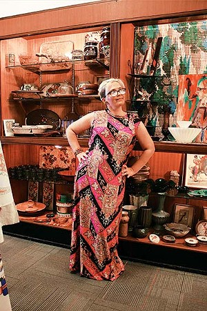 Local illustrator Carol Weems showing off a bold 70s-style print dress from Springfield Vintage. - PHOTO BY JOSEPH COPLEY. CLOTHING AND STYLE BY LINDA RENEHAN.