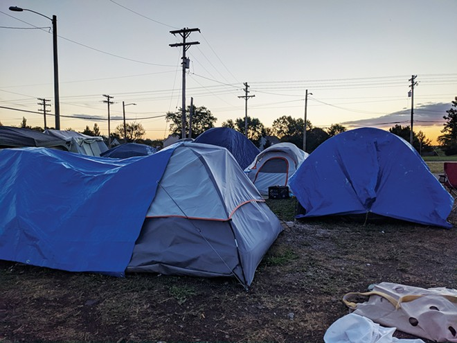 Tent City is calm at dawn as the homeless rest. - PHOTOS BY BRUCE RUSHTON
