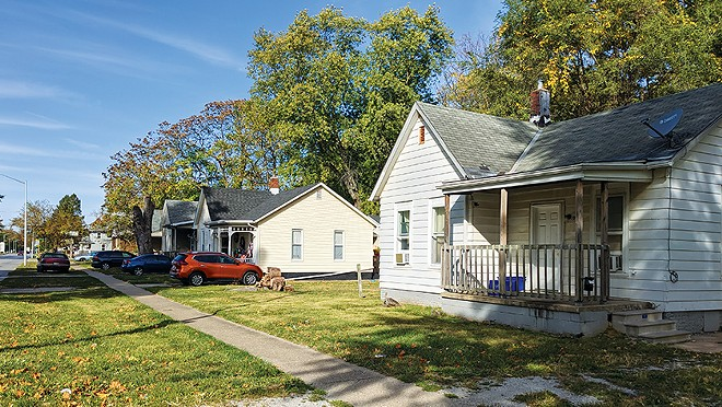 The city council has voted to buy Luann Hickman's home, yellow at center, on South Grand Avenue. - PHOTO BY BRUCE RUSHTON