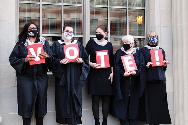 On Oct. 17, the Resistor Sisterhood organized activist women for a photo outside of the federal courthouse to honor the late Supreme Court justice Ruth Bader Ginsburg and encourage people to vote. - PHOTO BY DOCTOR MISTER DREAMER
