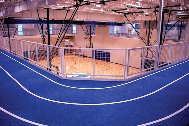 On the second-floor indoor track, 12 laps make a mile. - PHOTO BY ZACH ADAMS