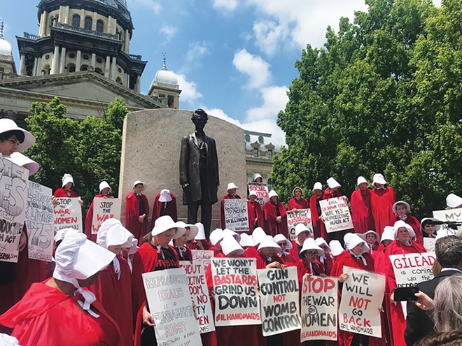 Women dressed as handmaids, a reference to The Handmaid's Tale, to support passage of the Reproductive Health Act in Illinois and rallied at the Capitol in 2019. - PHOTO COURTESY STATE REP. ANN WILLIAMS