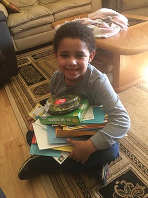 Jayden sits with his haul by mail for his recent birthday. - PHOTO COURTESY OF MARISSA HENSON