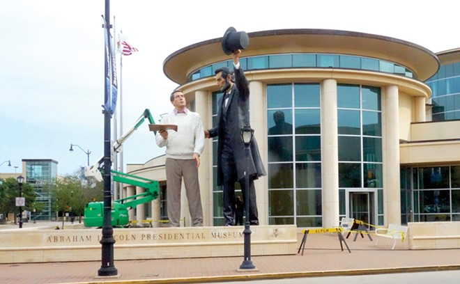 "A 31-foot-tall statue of Abraham Lincoln with a modern-day man holding the Gettysburg Address, named ""Return Visit,"" was installed in front of the Abraham Lincoln Presidential Library and Museum in May 2019. Last week it was dismantled and shipped to Washington, Illinois, for a temporary display. Bruce Rushton's recent opinion column imagined it gracing the entrance to a hypothetical Donald Trump Presidential Library and Museum to be built in Nevada."
