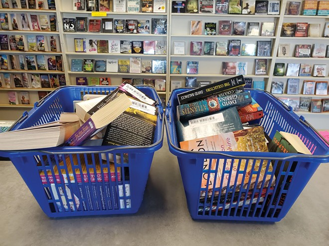 A: Some customers of The Book Rack, a used book store in Springfield, have been buying baskets full of books during the pandemic. - PHOTO BY STEPHANIE BOND
