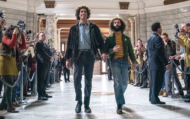 Sacha Baron Cohen as Abbie Hoffman and Jeremy Strong as Jerry Rubin in The Trial of the Chicago 7.