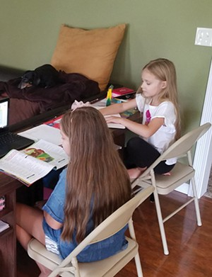 As students at Ball Charter, school board member Micah Miller's daughters continue to learn from home. - PHOTO COURTESY OF MICAH MILLE