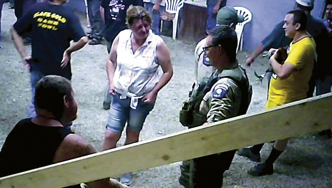 SHARK investigators last summer found sheriff's deputies at Kentucky cockfights. - PHOTOS COURTESY SHOWING ANIMALS RESPECT AND KINDNESS