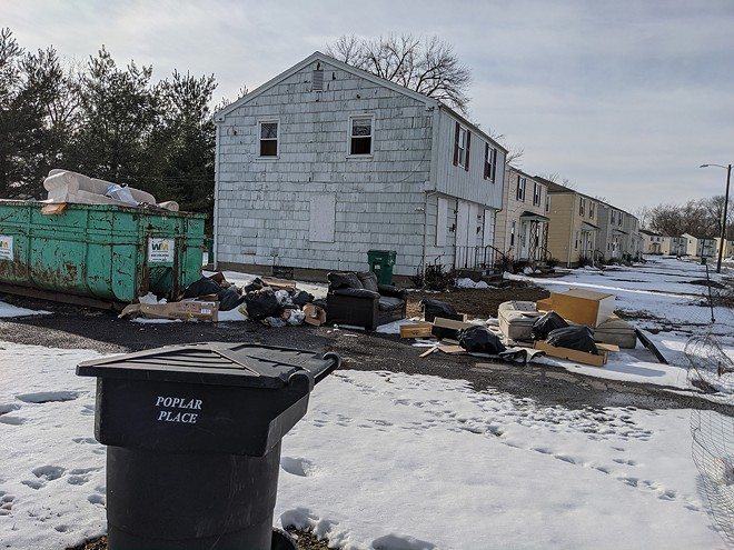 Nearly two years after the Illinois Housing Development Authority announced financing to fix Poplar Place, the east side development remains a mess. - PHOTO BY BRUCE RUSHTON