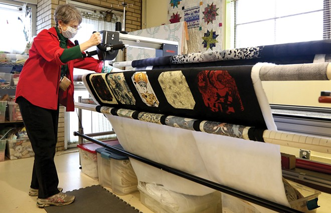 Anne Hennig uses a machine to sew a quilt at City Sewing Room in St. Louis. - PHOTO BY CHRISTINE TANNOUS/ST. LOUIS POST-DISPATCH/TNS