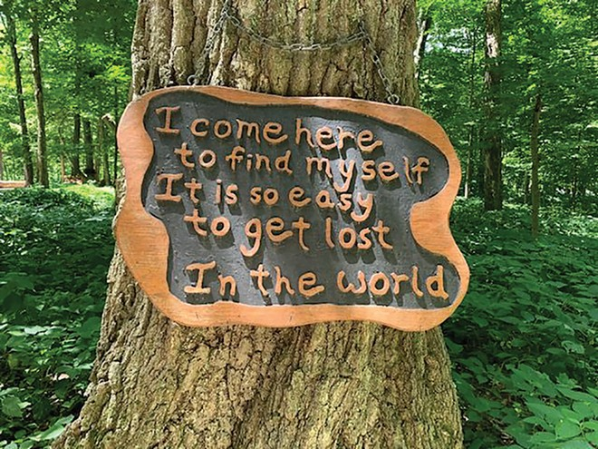 Some trees in the Chapel of the Templed Trees at Funk's Grove have sayings to - inspire visitors to the serene spot.