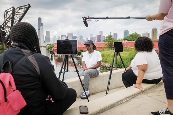 Teens from Chicago working with DePaul University to make a short film. DePaul professor and youth film project coordinator Liliane Calfee gave a presentation as part of the No Malice project. - CREDIT: DEPAUL UNIVERSITY