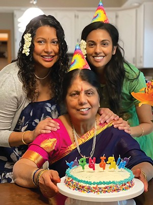Aruna Mundlapudi, center, on her 70th birthday with her daughters, Sacharitha Bowers, left, and Sankirtana Danner, right.