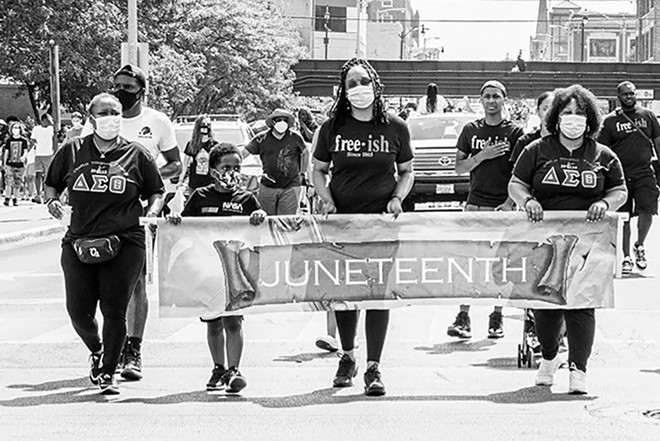 Shymeka Kerr-Gregory stands center at the head of last year's Juneteenth march to the Statehouse. - CREDIT: ZACH ADAMS, 1221 PHOTOGRAPHY