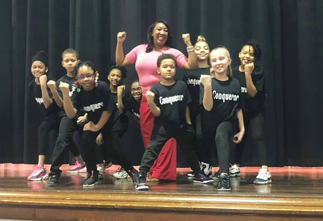 Erica Austin with a group of Feitshans Elementary School students who put on a play about Black inventors. - PHOTO COURTESY OF ERICA AUSTIN