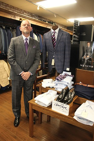 Terry Wilson, store manager at Jim Herron, Ltd., showing off his windowpane panel suit. - PHOTO BY JOSEPH COPLEY
