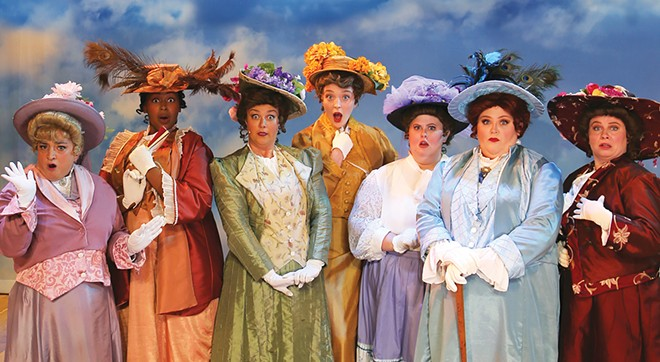 """The """"Pick-a-Little, Talk-a-Little"""" ladies dig the dish on Marian the Librarian. """"She advocated dirty books – Chaucer! Rabelais! Balzac! And made brazen overtures to a man who never had a friend!"""" from The Legacy Theatre's The Music Man. From L to R: Ethel Toffelmier (Missy Cartwright), Mrs. Squires (Aryanna Logan), Maude Dunlop (Betsy Buttell), Flora Merriweather (Rachel Larison), Opal Britt (Anna Benoit), The Mayor's wife Eulalie Mackecknie Shinn (Kinsey Peotter), and Alma Hix (Allison Means). - PHOTO BY LAURA KAY COFFEY"""