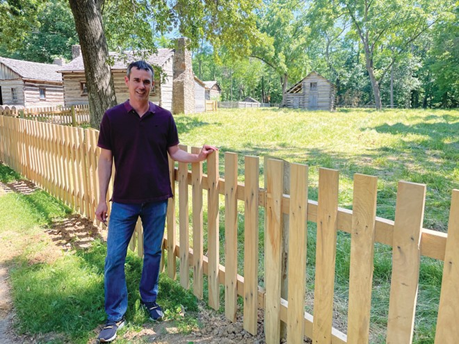 Lincoln's New Salem Historic Site Superintendent Jack Alexander with one of the site's new oak fences, which will corral a newly acquired pinto. - PHOTO BY WILLIAM FURRY