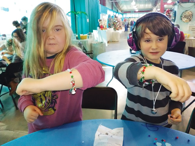 """(L-R) Kai Herbert and Luca Heathwaite show off the """"bros-lets"""" they made at Memorial's Festival of Trees. - PHOTO COURTESY OF CAREY SMITH"""