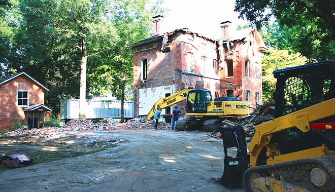 """As of Aug. 17, demolition of the historic Leland Farm House was in progress, despite last-ditch efforts from community members to save it. The owner, Frank Vala, told IT, """"I want a big yard. I bought this house with the intention to demolish it."""" - PHOTO BY STACIE LEWIS"""