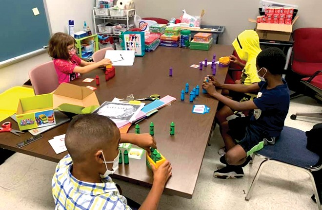 Second-graders at Camp Compass at Wilcox Elementary use letters to make words that match pictures. The summer programming has a focus on fun and play that leads to learning. - PHOTO BY LORI QUARTON, LITERACY COACH