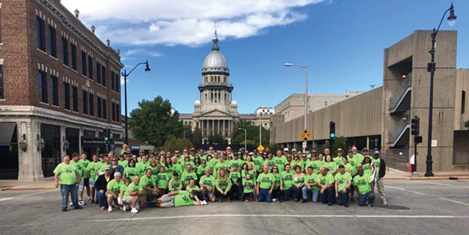 The Hot Rod Renegades car group pose near their preferred parking area on Capitol Street. - CREDIT: LOUIS JACKSON