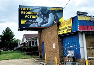 A billboard near the corner of Laurel and 11th streets features Rev. T. Ray McJunkins of Union Baptist Church and urges the community to get vaccinated. - PHOTO BY MARIA GARDNER