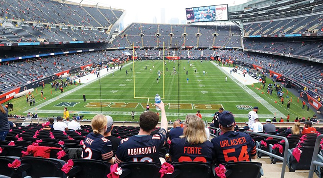 Fans settle into their seats prior to the start of a game between the Chicago Bears and the Detroit Lions at Soldier Field. - PHOTO BY CHRIS SWEDA