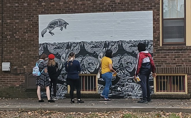 """On Oct. 2, onlookers took in a mural by Emmy Lingscheit. """"This project was influenced by the feeling of withdrawing into our private dens during the first winter of the pandemic, and the reminder that the world is both fragile and enduring,"""" the artist statement reads. - CREDIT: RACHEL OTWELL"""