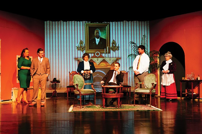 The reality-challenged Brewster family confronts the maniacal son (Chris Profiit) as the haunted visage of the pater familias (Tony Young) looks on from his portrait on the wall. From left Rachel Bridges, Al Gersh, Felicia Coulter, Profitt, Max Corlas, and Laurie McCoy in the Springfield Theatre Centre's Arsenic and Old Lace. - PHOTO BY MATT FRANKLIN